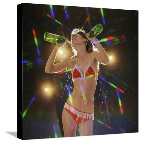 Go Go Dancer Pouring Water on Herself-Dennis Hallinan-Stretched Canvas Print