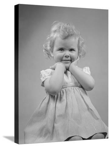 Baby Girl Smiling with Hands Next to Face--Stretched Canvas Print