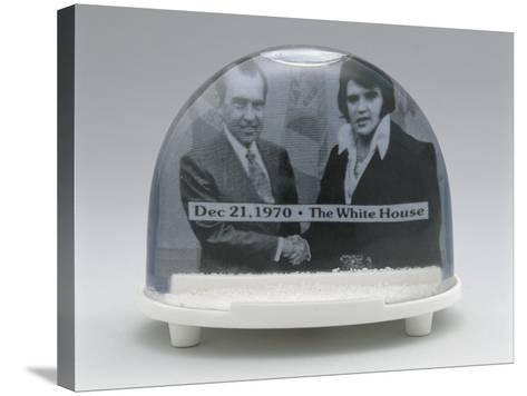 Close-Up of Figurines of Elvis Presley and Richard Nixon with Handshake in a Snow Globe--Stretched Canvas Print