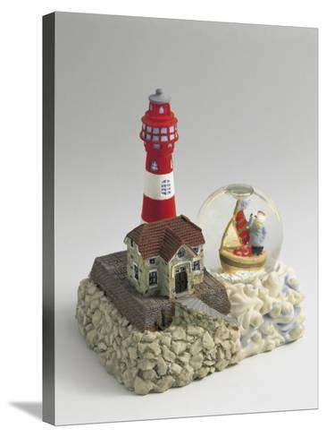 Figurine of a Lighthouse with a Snow Globe--Stretched Canvas Print