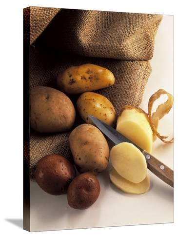 High Angle View of Raw Potatoes with a Knife-P^ Martini-Stretched Canvas Print