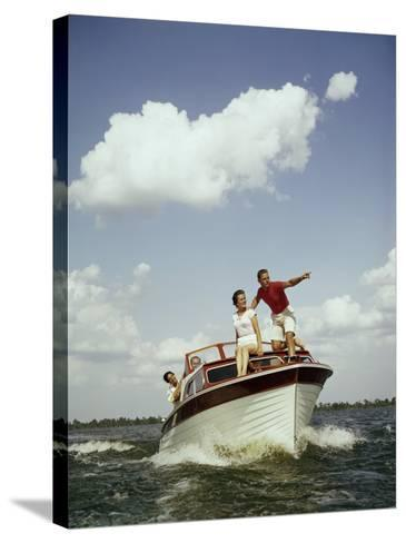 Couples Enjoy Speed Boat Ride-Dennis Hallinan-Stretched Canvas Print