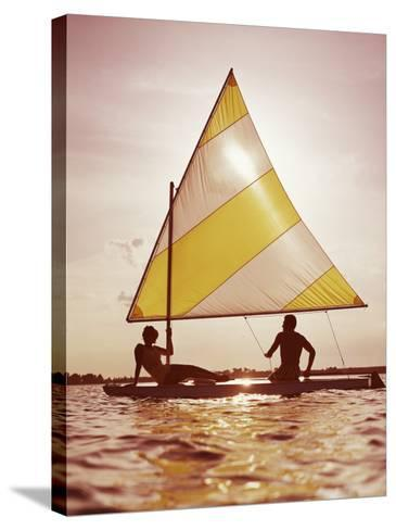 Couple Sailing on Small Boat-Dennis Hallinan-Stretched Canvas Print