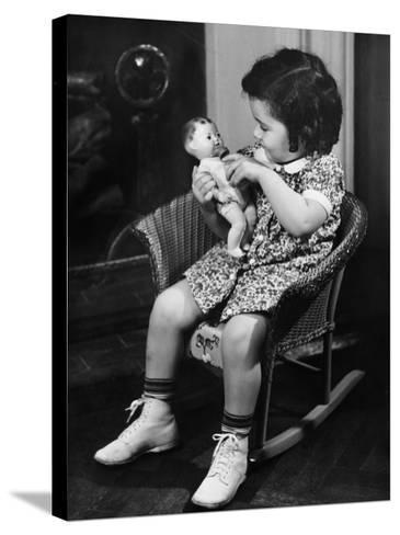 Girl (3-4) Sitting on Rocking-Chair, Playing with Doll-George Marks-Stretched Canvas Print