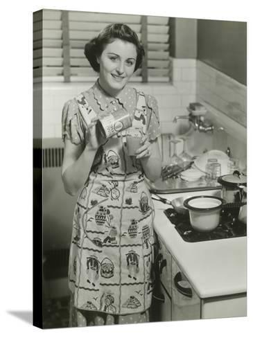 Portrait of Young Woman in Kitchen Holding Can of Soup-George Marks-Stretched Canvas Print