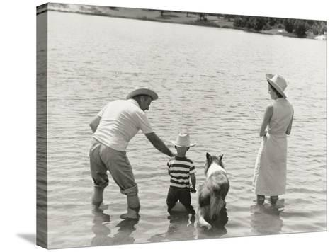 Family Fishing by Lake-Dennis Hallinan-Stretched Canvas Print