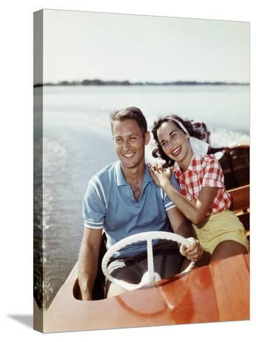Smiling Retro Couple Enjoying a Speed Boat Ride-Dennis Hallinan-Stretched Canvas Print