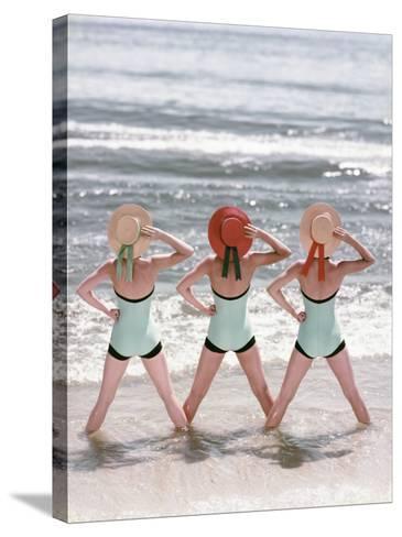 Women Standing on Beach in Ocean-Dennis Hallinan-Stretched Canvas Print
