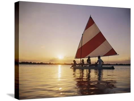 Family Sailing in Lake at Sunset-Dennis Hallinan-Stretched Canvas Print