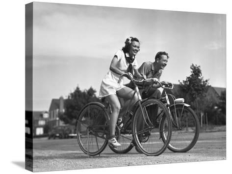 Man and Woman Riding Bicycles, (B&W),-George Marks-Stretched Canvas Print