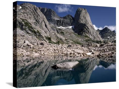 Rugged Landscape with Pingora Peak Reflection in Hidden Lake, Cirque of the Towers-Jeff Foott-Stretched Canvas Print
