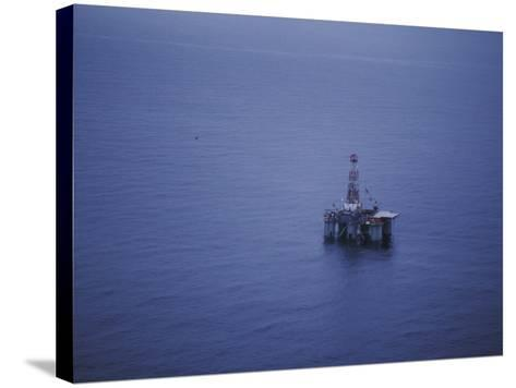 Offshore Oil Rig Surrounded by the Ocean-Jeff Foott-Stretched Canvas Print