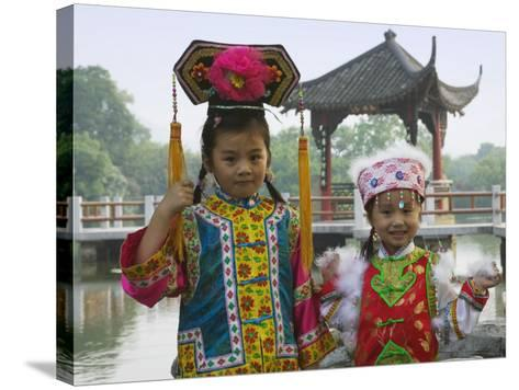 China, Zhejiang Province, Hangzhou, West Lake, Girls Dressed in Qing Dynasty Princess Costume-Keren Su-Stretched Canvas Print