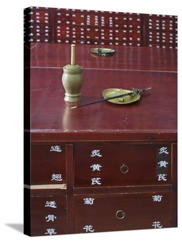 China, Beijing, Traditional Chinese Medicine Pharmacy, Scale and Mortar on the Counter-Keren Su-Stretched Canvas Print