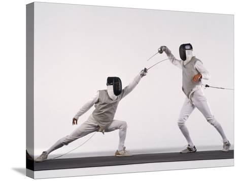 Male Fencer Making Lunging Attack in Foil--Stretched Canvas Print