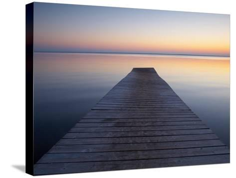 A Jetty by a Lake at Sunset--Stretched Canvas Print