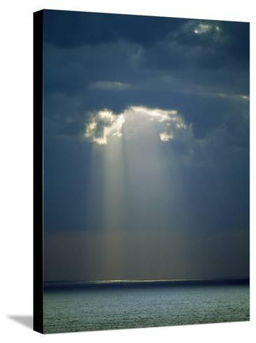 Sun Rays Reaching the Sea Through the Clouds--Stretched Canvas Print
