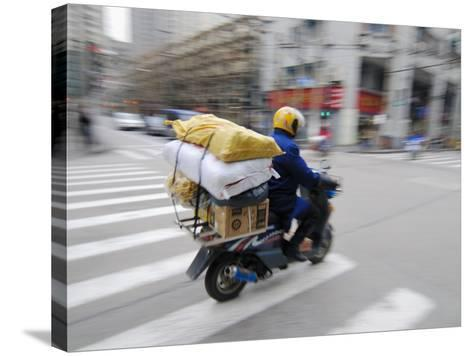 Man with Packages on Scooter--Stretched Canvas Print