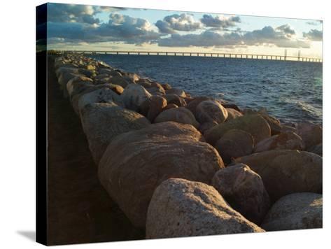 Rocks by the Sea at Oresund, the Oresund Bridge in Background--Stretched Canvas Print