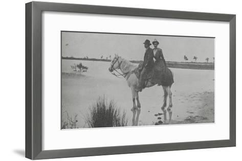 Couple on Horseback in Traditional Costume of Arles--Framed Art Print