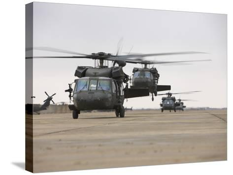 UH-60 Black Hawks Taxis Out for a Mission over Northern Iraq--Stretched Canvas Print