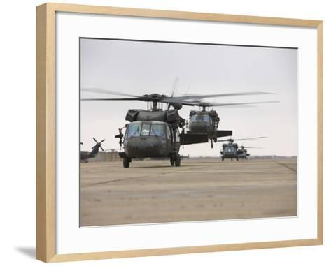UH-60 Black Hawks Taxis Out for a Mission over Northern Iraq--Framed Art Print