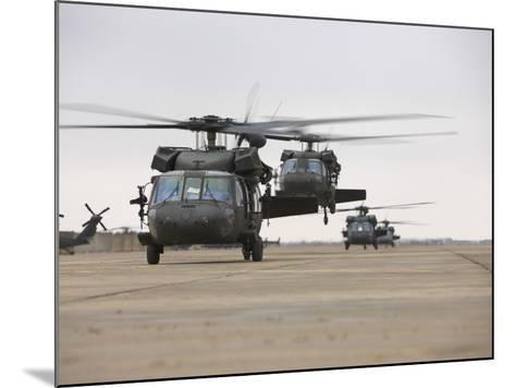 UH-60 Black Hawks Taxis Out for a Mission over Northern Iraq--Mounted Photographic Print
