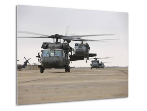 UH-60 Black Hawks Taxis Out for a Mission over Northern Iraq--Metal Print