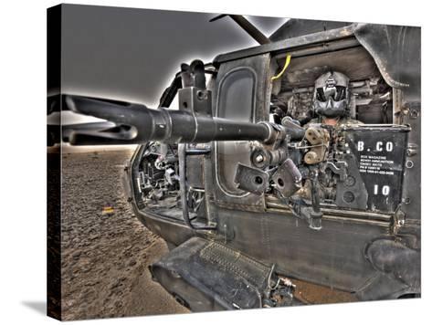 A UH-60 Black Hawk Door Gunner Manning a M240G Medium Machine Gun--Stretched Canvas Print
