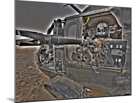 A UH-60 Black Hawk Door Gunner Manning a M240G Medium Machine Gun--Mounted Photographic Print