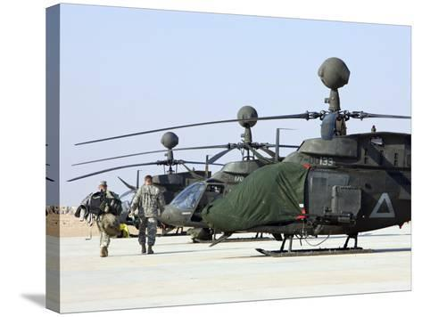 Oh-58D Kiowa Warrior Helicopters Parked at Camp Speicher, Iraq--Stretched Canvas Print