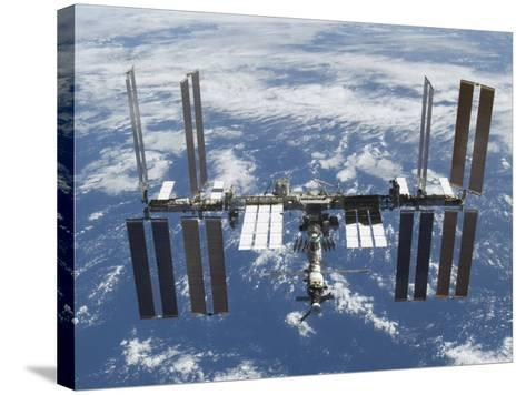 International Space Station in Orbit Above the Earth--Stretched Canvas Print