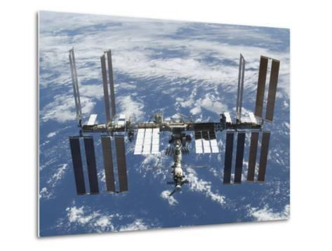 International Space Station in Orbit Above the Earth--Metal Print