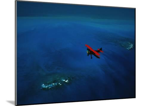 An Airplane Flying over Water-David Doubilet-Mounted Photographic Print