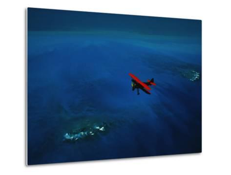 An Airplane Flying over Water-David Doubilet-Metal Print