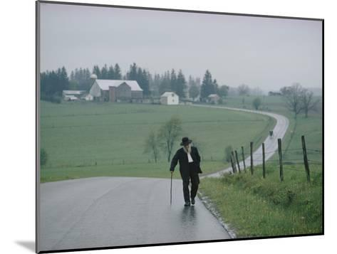 An 81 Year Old Amish Man Walks to the Amish Church on Sunday Morning-Robert Madden-Mounted Photographic Print