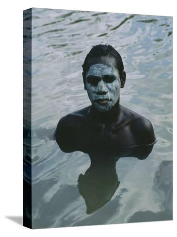 Aboriginal Teen with a Mask of Mud, Swimming in a Billabong-Sam Abell-Stretched Canvas Print