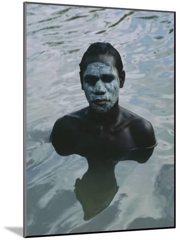 Aboriginal Teen with a Mask of Mud, Swimming in a Billabong-Sam Abell-Mounted Photographic Print