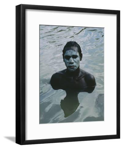 Aboriginal Teen with a Mask of Mud, Swimming in a Billabong-Sam Abell-Framed Art Print
