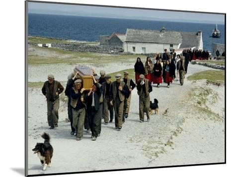 Village Men Carry a Coffin, Women in Red Skirts Follow in Procession-Jim Sugar-Mounted Photographic Print