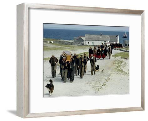 Village Men Carry a Coffin, Women in Red Skirts Follow in Procession-Jim Sugar-Framed Art Print
