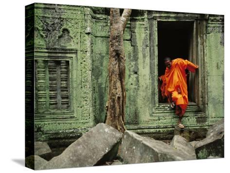 A Monk Emerges from the Doorway of an Angkor Wat Temple-Steve Raymer-Stretched Canvas Print