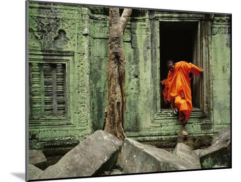 A Monk Emerges from the Doorway of an Angkor Wat Temple-Steve Raymer-Mounted Photographic Print