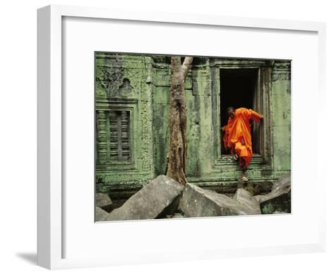 A Monk Emerges from the Doorway of an Angkor Wat Temple-Steve Raymer-Framed Art Print