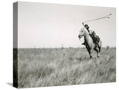 Whirling His Boleadoras, a Man Charges after an Ostrich-Luis Marden-Stretched Canvas Print