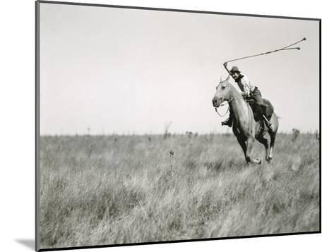 Whirling His Boleadoras, a Man Charges after an Ostrich-Luis Marden-Mounted Photographic Print