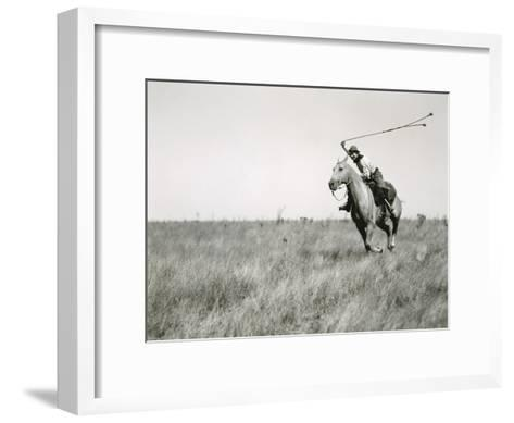 Whirling His Boleadoras, a Man Charges after an Ostrich-Luis Marden-Framed Art Print