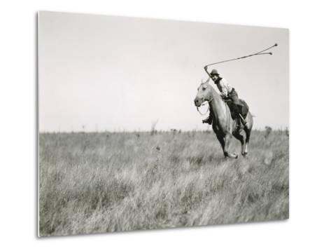 Whirling His Boleadoras, a Man Charges after an Ostrich-Luis Marden-Metal Print