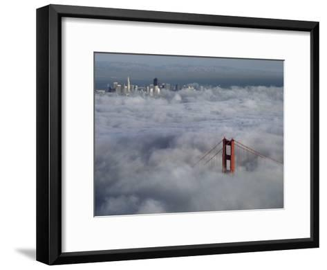 A Glowing Tower of the Golden Gate Bridge Rises Above the Fog-Jim Sugar-Framed Art Print