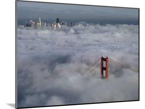 A Glowing Tower of the Golden Gate Bridge Rises Above the Fog-Jim Sugar-Mounted Photographic Print